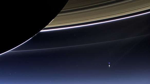 this-humbling-photo-taken-by-nasas-cassini-spacecraft-in-2013-shows-what-earth-indicated-by-the-tiny-white-arrow-looks-like-from-898-million-miles-away
