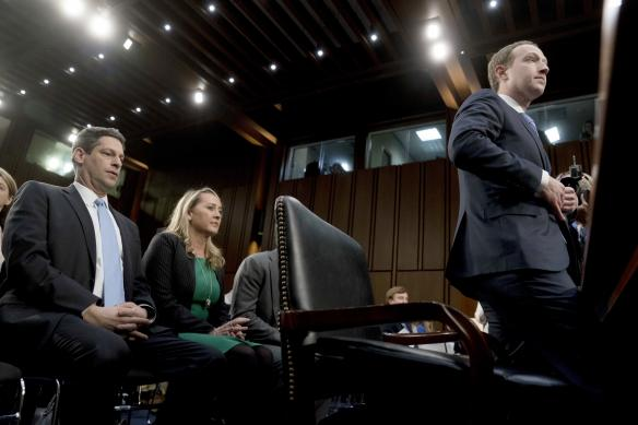 Facebook CEO Mark Zuckerberg returns from a break as he testifies before a joint hearing of the Commerce and Judiciary Committees on Capitol Hill in Washington, Tuesday, April 10, 2018, about the use of Facebook data to target American voters in the 2016 election. (AP Photo/Andrew Harnik)