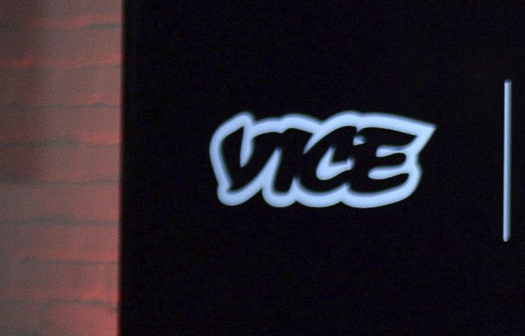 """FILE - In this Oct. 30, 2014, file photo, the Vice logo is seen at a joint venture announcement between Vice Media and Roger Communications in Toronto. For all the words flowing since last weekend in Charlottesville, Va., the most striking television reporting has been Vice Media's insider account of the white nationalist movement and the aftermath of their demonstration. Correspondent Elle Reeve's story was first shown on HBO's """"Vice News Tonight"""" on Monday, Aug. 14, 2017, and has been seen more than 36 million times on television and streaming platforms. (Nathan Denette/The Canadian Press via AP, File)"""