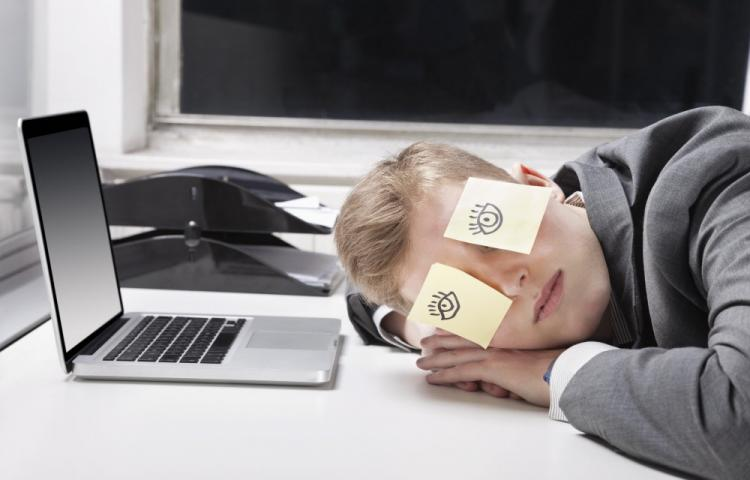 Mandatory Credit: Photo by Mood Board / Rex Features (2127457a) MODEL RELEASED Businessman sleeping with sticky notes on eyes at desk in office VARIOUS