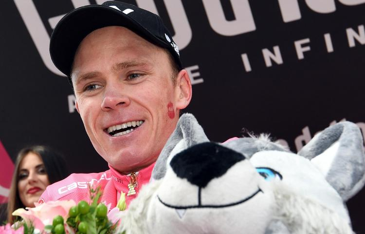 Britain's Chris Froome, the new overall leader of the race, wears the pink jersey on podium after winning the the 19th stage of the Giro d'Italia cycling race, from Venaria Reale to Bardonecchia, in Bardonecchia, Italy, Friday, May 25, 2018. (Daniel dal Zennaro/ANSA via AP)