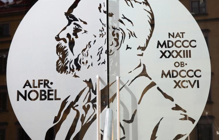 STOCKHOLM, SWEDEN - May 21, 2015: Portrait of Alfred Nobel on the glass door of Swedish Academy and Nobel Museum in Stockholm