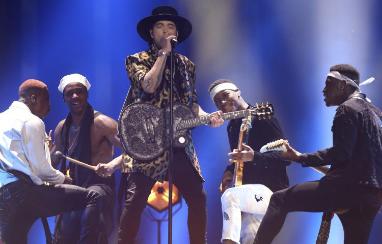 Waylon from the Netherlands performs the song 'Outlaw In Em' in Lisbon, Portugal, Saturday, May 12, 2018 during the Eurovision Song Contest grand final. (AP Photo/Armando Franca)
