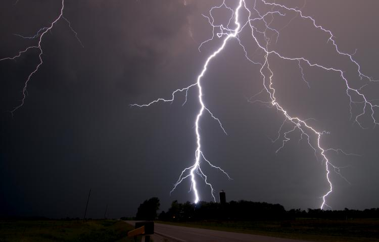 East of Princeton, Kansas, a lightning bolt hits on May 24, 2012. It came from a thunderstorm that had a beautiful mothership structure, at first. As the storm weakened, it produced a doughnut-shaped, quick-moving outflow boundary and then a barrage of intense lightning. This bolt was so close, the thunder occurred almost simultaneously with the lightning. Photo by Chris Kridler, SkyDiary.com, ChrisKridler.com, SkyDiary.com, ChrisKridler.com