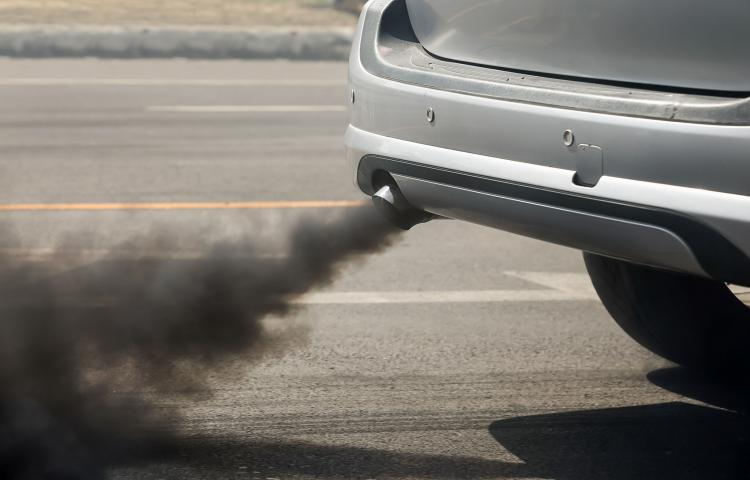 66964403 - air pollution from vehicle exhaust pipe on road