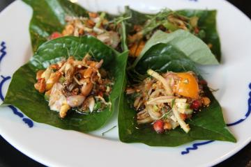 """*** EXCLUSIVE - VIDEO AVAILABLE ***  HIGHBURY, LONDON - JULY 2017: Cricket flour Miang with fresh ginger, peanuts, coconut, served in a Betal Leaf. taken in Highbury, London, July 2017.  AT MOST restaurants you?d probably complain if you found an insect in your dinner, but at Eat Grub?s popup restaurants, that?s exactly the point. Selling roasted crickets with garden herbs, edible grasshoppers, insect protein powders and energy bars, Eat Grub also puts on pop-up dining experiences to promote using insects as a sustainable and delicious food source. One of the founders Shami Radia said: """"We think that actually they can be easily incorporated into people?s daily lives, instead of having nuts or crisps while watching the football you can have some roasted crickets."""" Along with chef Seb Holmes, co-founders Shami and Neil Whippey, devised a 5-course meal for their latest pop-up, which combined chef Seb?s love of Thai street food and the co-founders? passion for insects. Grasshoppers, meal worms, house crickets and buffalo worms were all on the menu at the pop-up.  PHOTOGRAPH BY Jay Sohrabi / Barcroft Images  London-T:+44 207 033 1031 E:hello@barcroftmedia.com - New York-T:+1 212 796 2458 E:hello@barcroftusa.com - New Delhi-T:+91 11 4053 2429 E:hello@barcroftindia.com www.barcroftimages.com"""