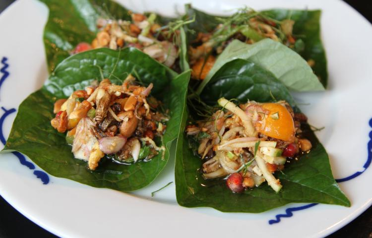 "*** EXCLUSIVE - VIDEO AVAILABLE ***  HIGHBURY, LONDON - JULY 2017: Cricket flour Miang with fresh ginger, peanuts, coconut, served in a Betal Leaf. taken in Highbury, London, July 2017.  AT MOST restaurants you?d probably complain if you found an insect in your dinner, but at Eat Grub?s popup restaurants, that?s exactly the point. Selling roasted crickets with garden herbs, edible grasshoppers, insect protein powders and energy bars, Eat Grub also puts on pop-up dining experiences to promote using insects as a sustainable and delicious food source. One of the founders Shami Radia said: ""We think that actually they can be easily incorporated into people?s daily lives, instead of having nuts or crisps while watching the football you can have some roasted crickets."" Along with chef Seb Holmes, co-founders Shami and Neil Whippey, devised a 5-course meal for their latest pop-up, which combined chef Seb?s love of Thai street food and the co-founders? passion for insects. Grasshoppers, meal worms, house crickets and buffalo worms were all on the menu at the pop-up.  PHOTOGRAPH BY Jay Sohrabi / Barcroft Images  London-T:+44 207 033 1031 E:hello@barcroftmedia.com - New York-T:+1 212 796 2458 E:hello@barcroftusa.com - New Delhi-T:+91 11 4053 2429 E:hello@barcroftindia.com www.barcroftimages.com"