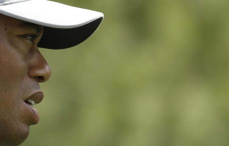 Tiger Woods looks at his shot on the fifth hole during the first round for the Masters golf tournament Thursday, April 11, 2019, in Augusta, Ga. (AP Photo/Charlie Riedel)
