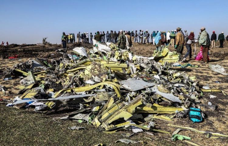 people-stand-near-collected-debris-at-the-crash-site-of-news-photo-1129799170-1552316414