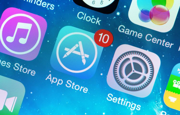 KIEV, UKRAINE - JUNE 12, 2014: A close-up photo of Apple iPhone 5s start screen with application icons, includes App Store, Settings, Clock, Game Center and others. App Store is a digital distribution service for mobile apps on iOS platform, developed by Apple Inc.