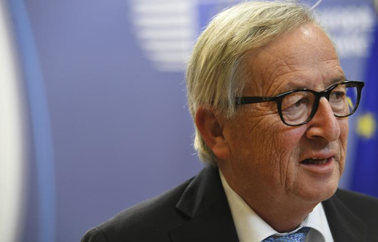European Commission President Jean-Claude Juncker speaks with the media during an EU summit at the Europa building in Brussels, Friday, June 21, 2019. European Union leaders have failed to back a plan to make the bloc's economy carbon neutral by 2050 in spite of promises to fight harder against climate change. (AP Photo/Riccardo Pareggiani)