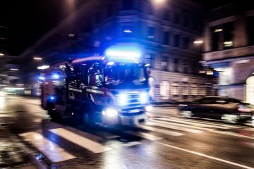 38986478 - fast driving fire truck in a night city