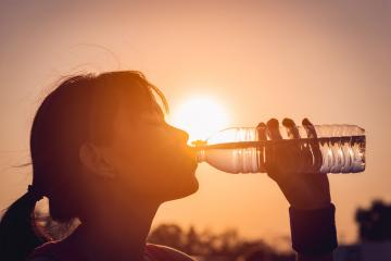 Female drinking a bottle of water