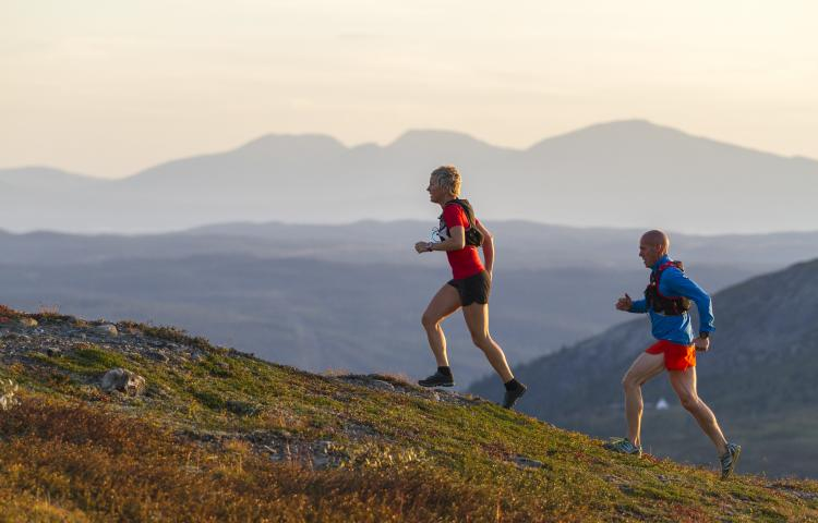 Couple running in mountains