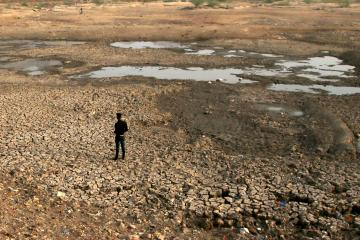 June 7, 2019, Ajmer, India: A man stands in a parched bed of the Chaurasiawas Lake that dried up due to hot weather in Ajmer, Rajasthan India. (Credit Image: © Str/NurPhoto via ZUMA Press