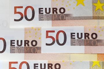close-up photo of fifty euros stacked on top of each other