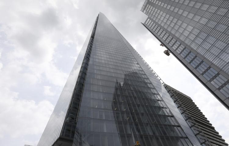 The Shard building, one of the tallest buildings in Europe, reaches up from the city of London, Monday, July, 8, 2019.  A free climber, no name released by police, scaled The Shard without safety equipment, earlier Monday. (AP Photo/Natasha Livingstone)