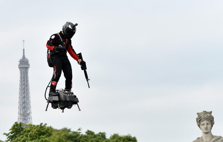 PARIS, FRANCE - JULY 14: French pilot Franky Zapata performs with flyboard, which the French army is considering using for military purposes during the annual Bastille Day military parade in Paris, France on July 14, 2019.  Mustafa Yalcin / Anadolu Agency